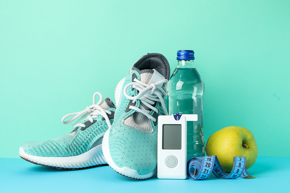 Exercise and healthy eating items with glucose monitor